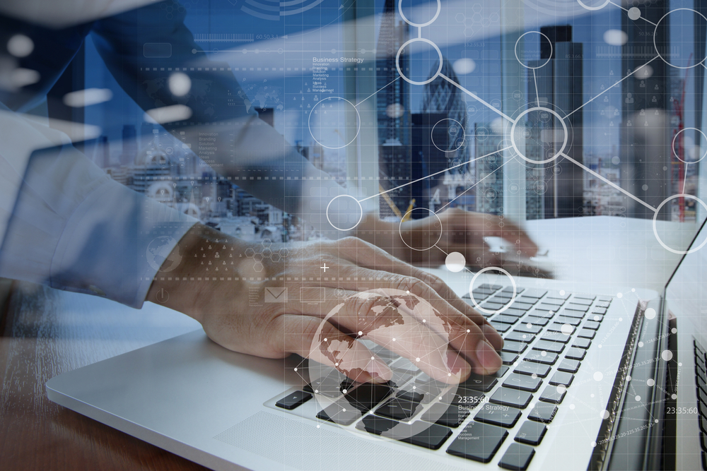 businessman hand working with modern technology and digital layer effect as business strategy concept-1